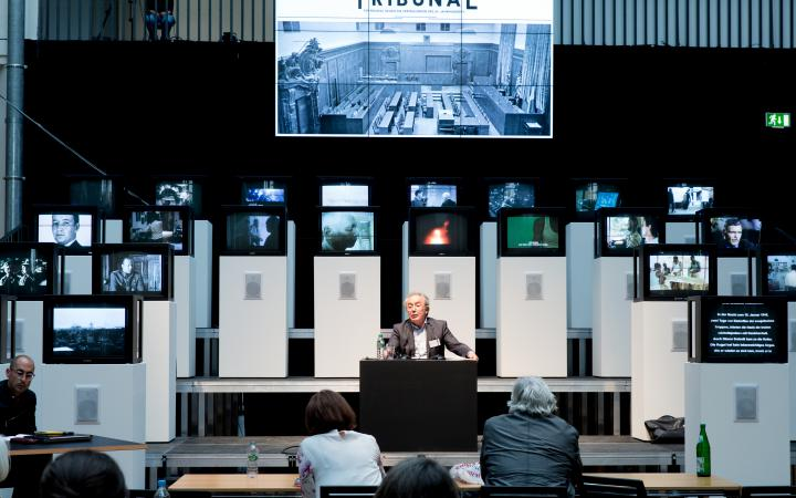 A man sitting in front of several screens