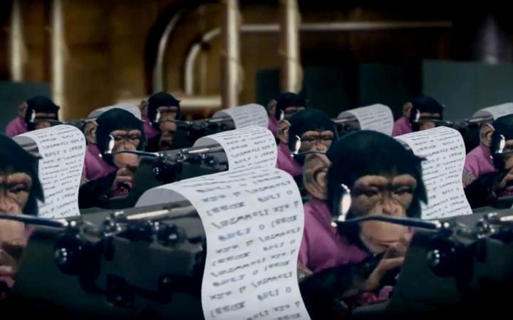 Chimpanzees sit at typewriters