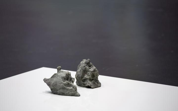 Two stones lay on a white plate