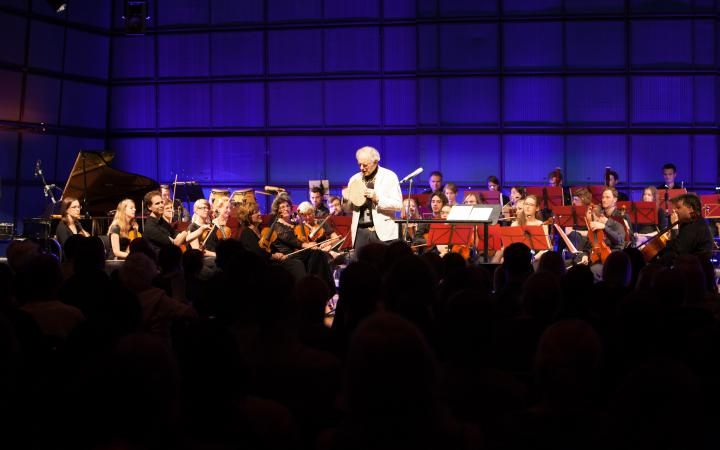 David Amram in front of an orchestra