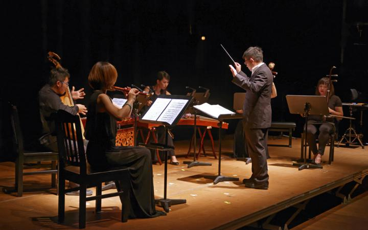 A four-piece orchestra with a conductor
