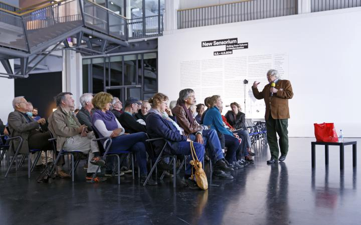 A man talking to the audience