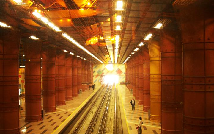 A metro station dipped in golden light