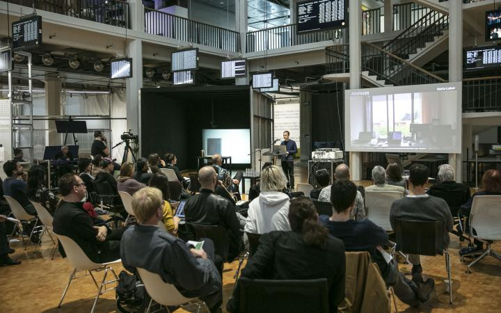 The picture shows the Open Conference about Art and Artificial Intelligence