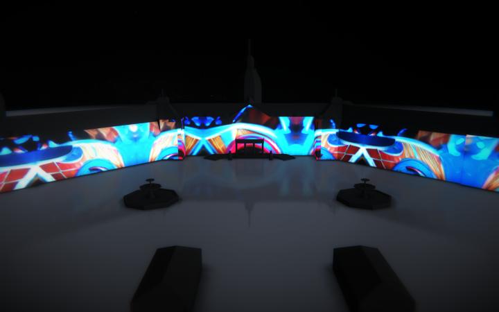 Zu sehen ist eine Visualisierung des beleuchteten Karlsruher Schlosses. Projiziert werden bunte Ornamente