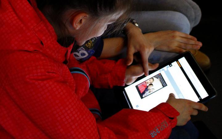 kids playing a digital game