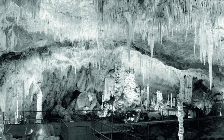 """A black-and-white photograph of the cave """"Grotte des Canalettes"""""""