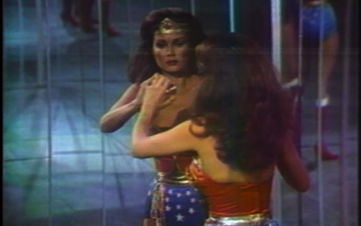 The Super Heroine Wonder Woman looks at herself for the first time in the mirror after her transformation.