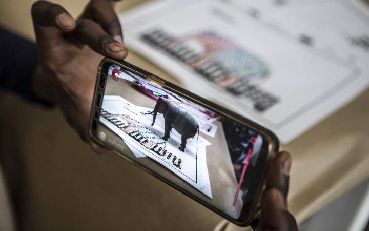 On a mobile phone display an elephant appears in Augmented Reality