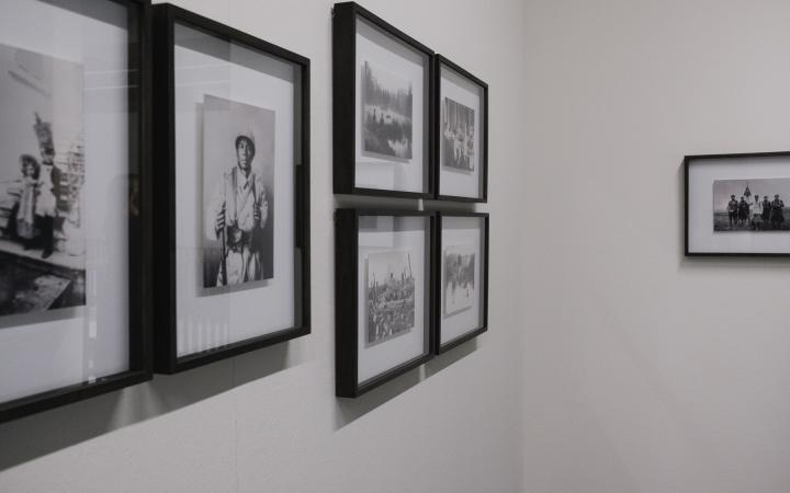 Different pictures hang on the wall