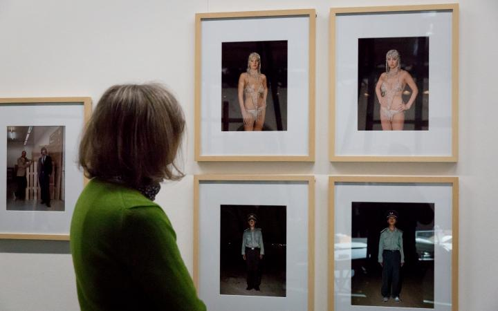 A woman looks at several photographs