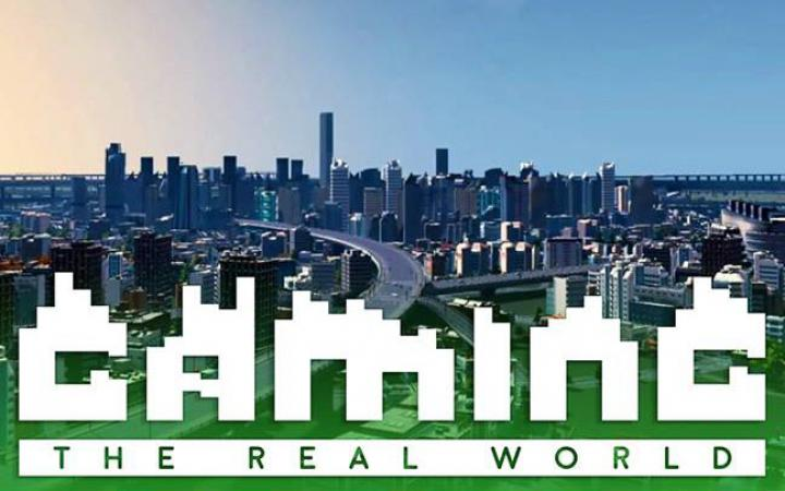 """The skyline of a big city with the lettering """"Gaming the real world"""""""