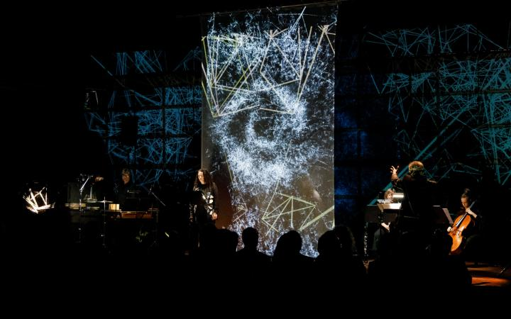 Musicians in front of an LED wall with visualizations