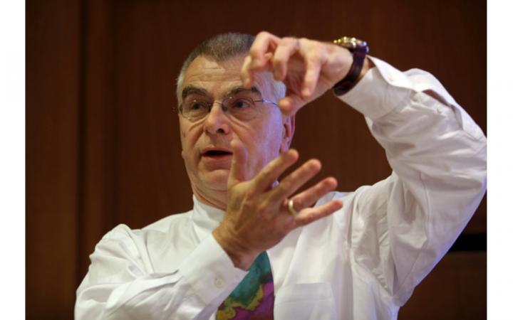 Close-up of György Buzsáki talking and gesticulating.