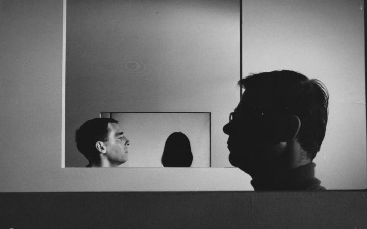You can see the side profile of two men, which are offset from each other.
