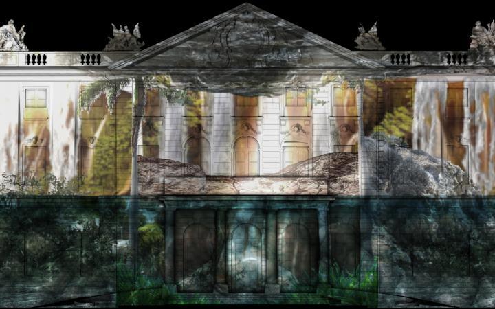Zu sehen ist das beleuchtete Karlsruher Schloss. Projiziert wurden zwei Landschaften, die sich in Welt und Unterwelt aufteilen.