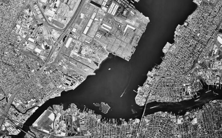 Jersey City from above. Houses and a river.