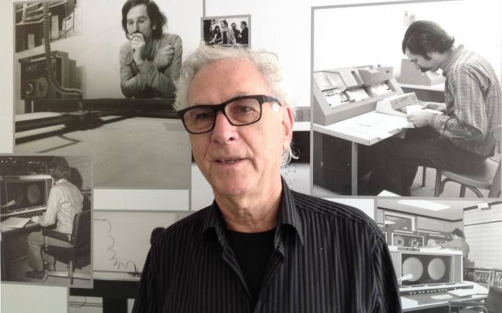 Portrait of the artist Manfred Mohr. In the background black and white photos showing the artist in 1971.