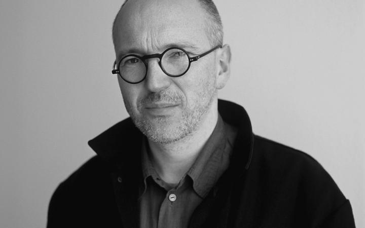 A black and white portrait of the artist Ecke Bonk