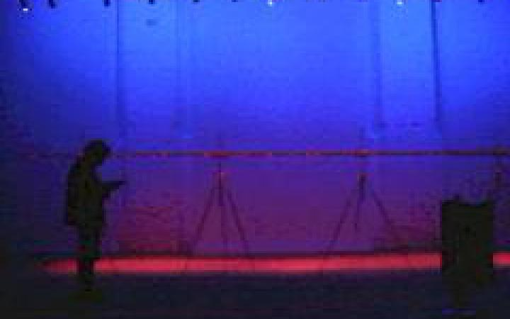 A empty room glowing in blue and red
