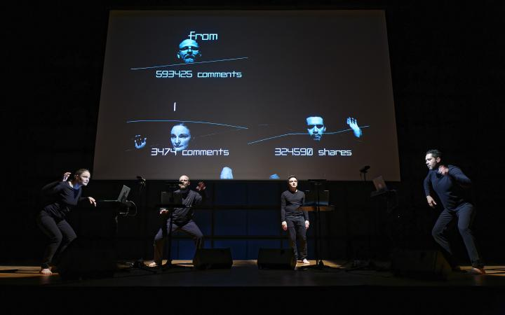 Four artists on stage in front of a screen