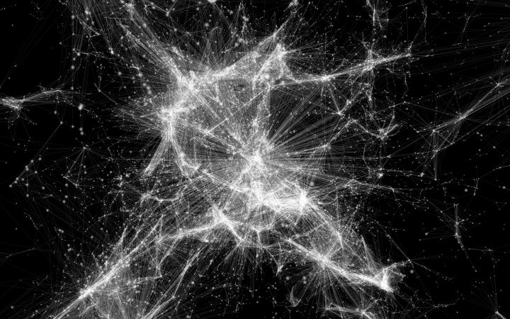 Zu sehen ist eine Visualisierung eines Netzwerkes. Es sieht aus wie ein Spinnennetz.