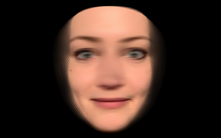 You can see a blurred face of a woman framed in black.