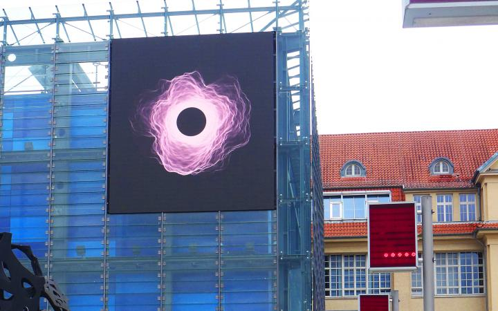 Crypto art on the LED wall of the ZKM Cube