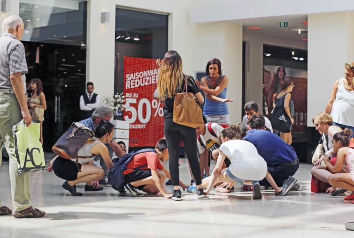 People sit on the floor
