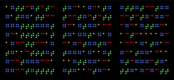 Anordnung verschieden farbiger Punkte auf schwarzem Grund