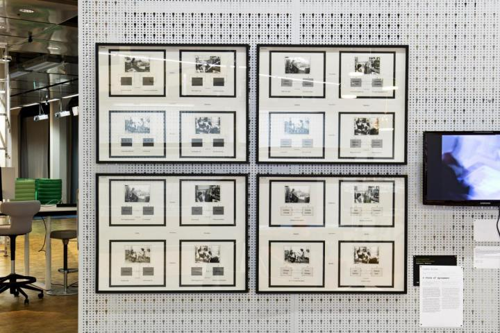 Installation of four frames with four pictures each on one wall