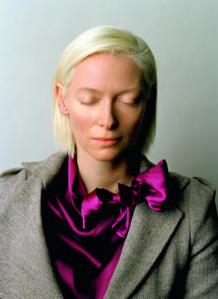 A woman, Tilda Swinton, with her eyes closed.