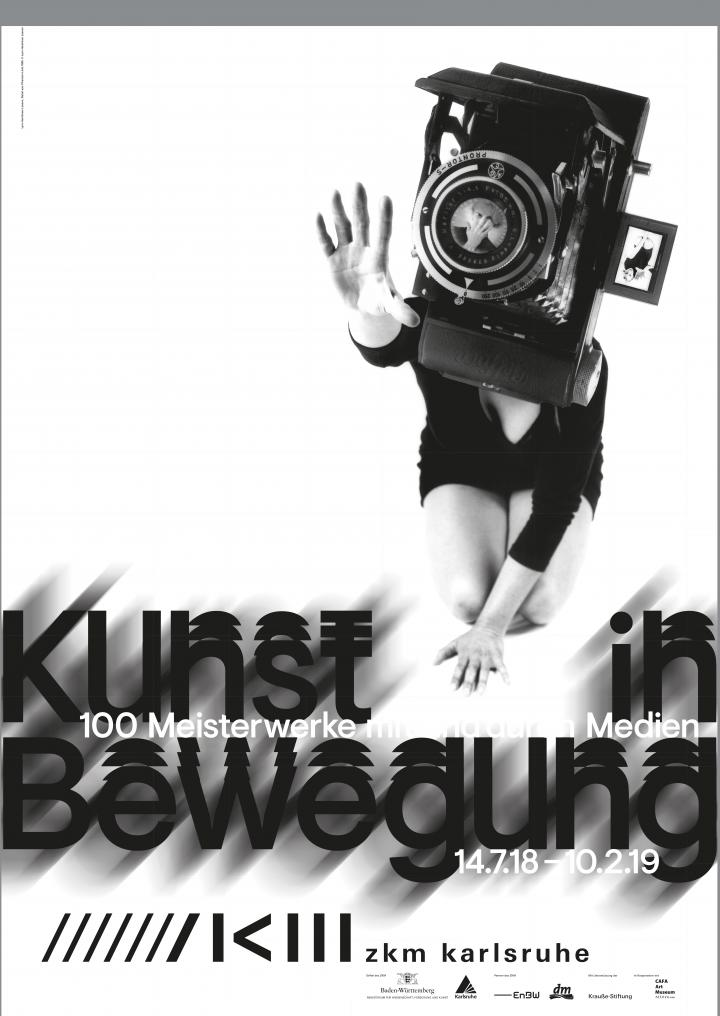 The poster of the exhibition »Art in Motion« shows a kneeling woman whose head is covered by an oversized camera.