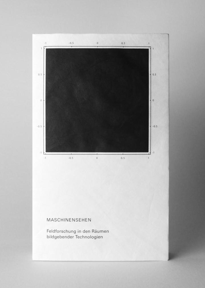 A black book cover with a black title and a black square