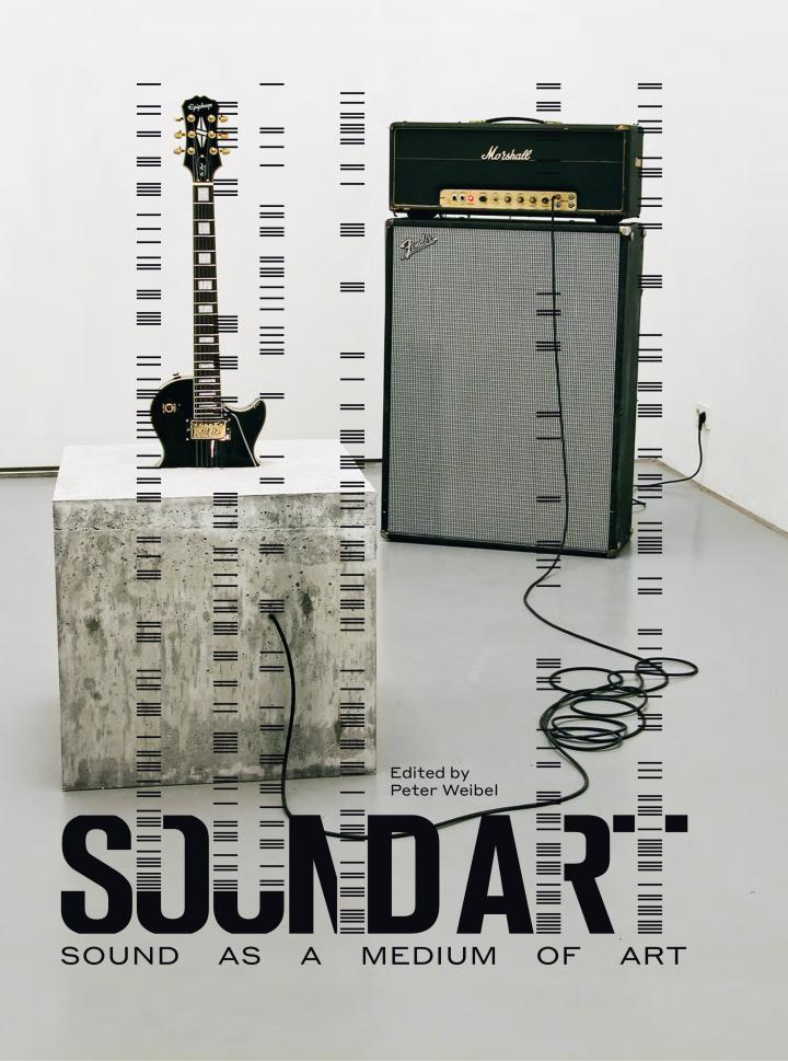 """The cover of the publication """"Sound Art. Sound as a Medium of Art"""". On view is the artwork of Douglas Henderson, """"stop."""" from 2007 - an electric guitar half in cement in a concrete cube; connected with a Marshal amplifier and a Fender box."""