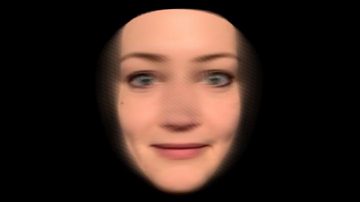 Zu sehen ist ein verschwommenes Gesicht einer Frau, das schwarz eingerahmt ist.